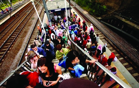 Visitors clad in Bedouin attire get off the overground