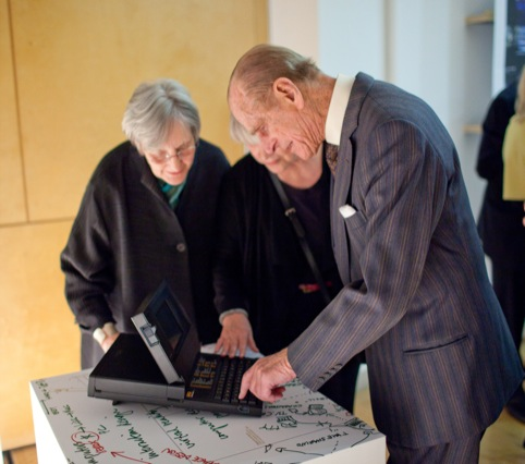 HRH PRince Philip looking at Grid Computer