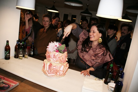 Amelia Gregory cutting her enormous Lilly Vanilli cake