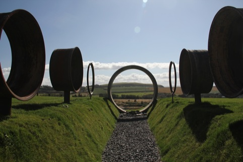 Charles Jencks, The Avenue of Doubles focuses through a sewer pipe on a volcano 375 million years old