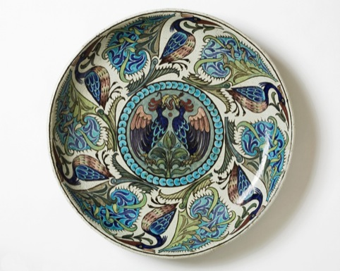 Large circular earthenware dish designed by William de Morgan thought to date from between 1888 and 1911