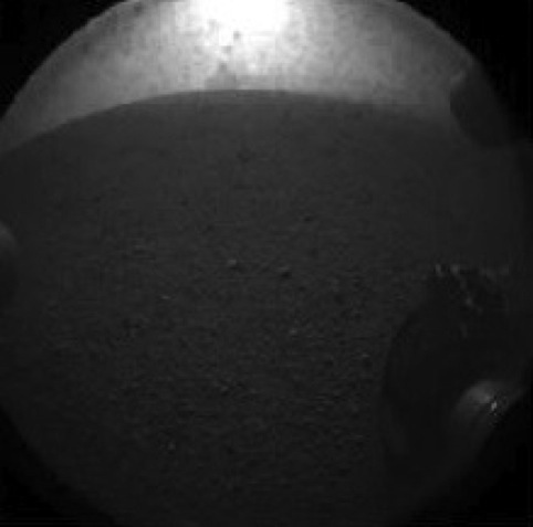 The first photo broadcast from the Curiosity Rover