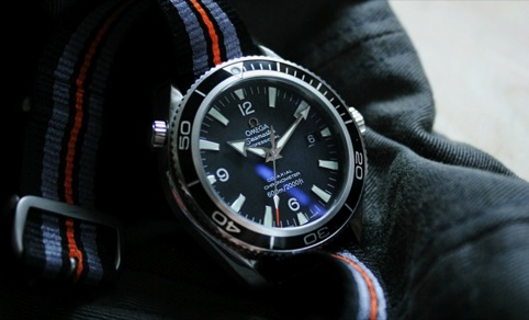 An Omega Seamaster watch (grappling hook not featured)