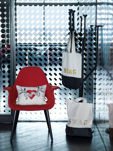 Swag bags and hearts and birds on chair.