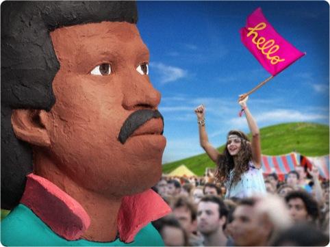 A reveller celebrates Lionel Richie's massive head