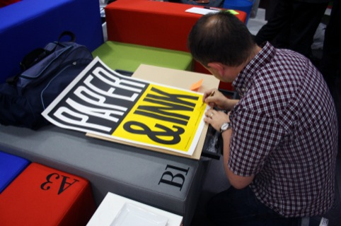 Anthony Burill with one of the prints