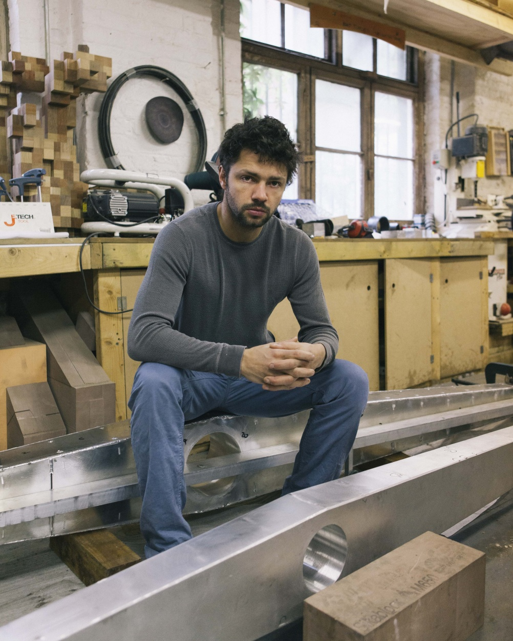 Conrad Shawcross in his studio with a fragment of Timepiece (2013)