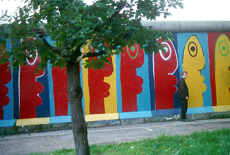 Thierry Noir standing by the Berlin Wall in the 1980s.