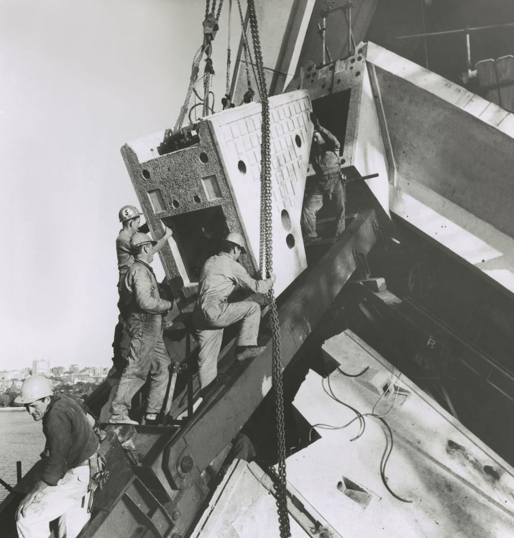 Installing a ridge beam segment on main shell, 1966
