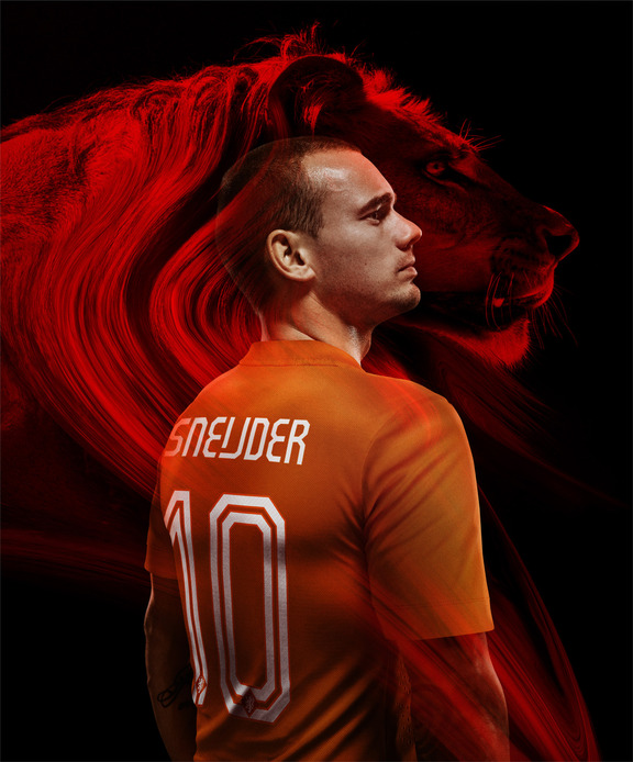 Wesley Sneijder models the Dutch home shirt with type insired by Wim Crouwel