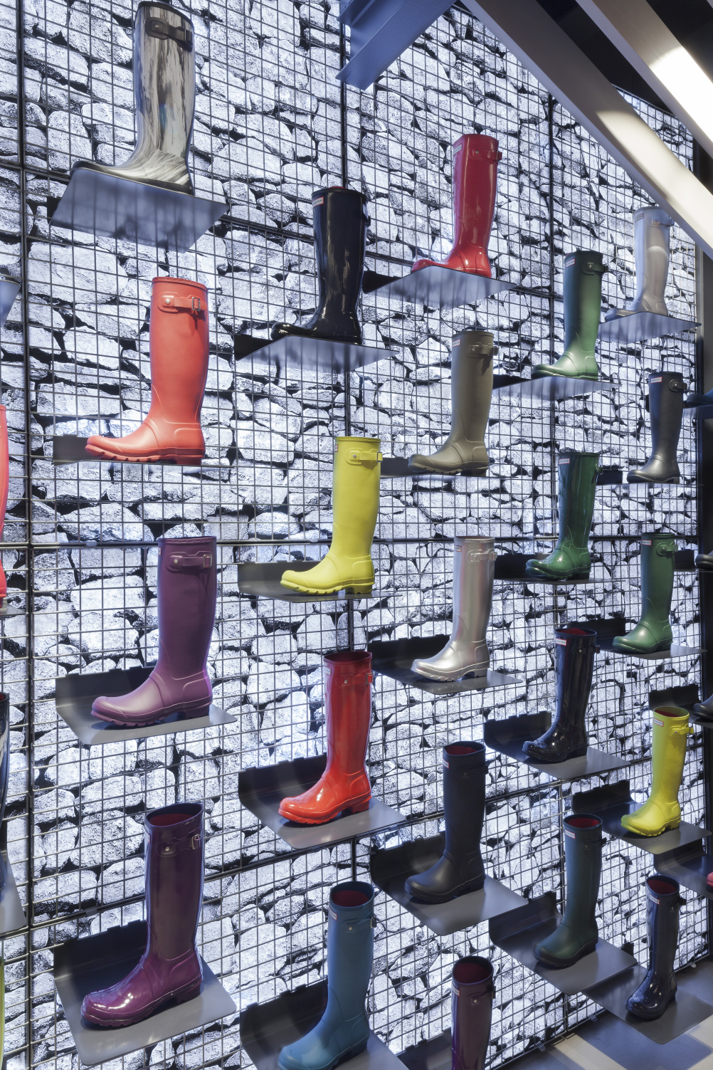 Boots displayed against the gabion wall