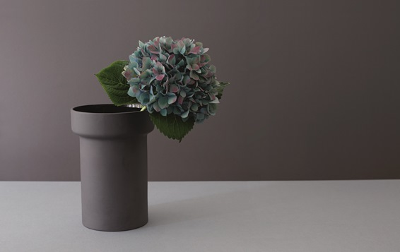 Vase inspired by the beginnings of Royal Doulton, which started out by producing glazed water pipes.