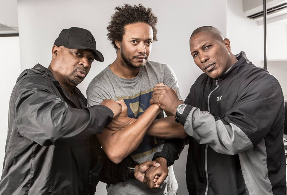 Madina (centre) with Public Enemy's Chuck D and S1W's James Bomb