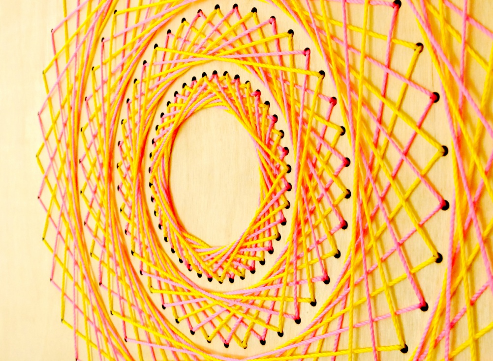 By Mr Gresty. Laser cut ply wood with yellow and pink string