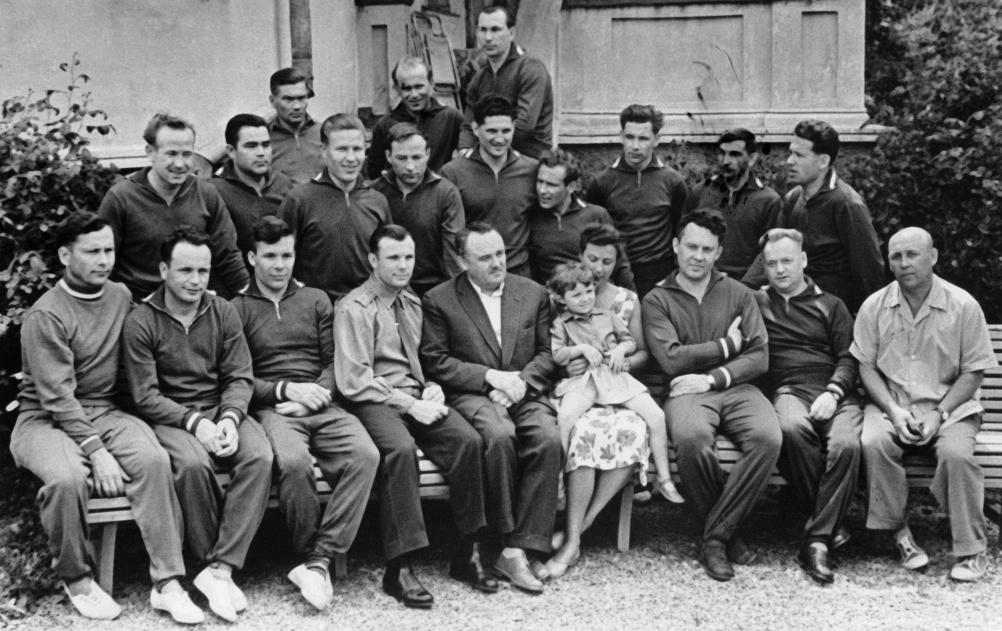 1961, first Soviet Cosmonaut squad. Front row, left to right: P. Popovich, V. Gorbatko, Y. Khrunov, Yuri Gagarin, chief designer Sergei Korolev, N. Koroleva with Popovich's daughter Natasha, Ye. Karpov, head of cosmonaut group, parachute jumping instructor N. Nikitin and doctor Y. Fyodorov. Back row, left to right: A. Leonov, A. Nikolayev, M. Rafikov, D. Zaikin, B. Volynov, G. Titov, G. Nelyubov, Valery Bykovsky and G. Shonin. Third row, left to right: V. Filatyev, I. Anikeyev and P. Belyayev. [16 from original group of 20 trainee cosmonauts are pictured. 11 of these flew in space.] RIA Novosti/RIA Novosti.