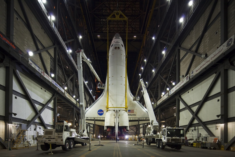 CAPE CAPAVERAL, FL - APRIL 13: Space Shuttle Atlantis hangs suspended from a sling before being mated to the external tank inside the vehicle assembly building at Kennedy Space Center on April 13, 2010 in Cape Canaveral, Florida. Atlantis is preparing for its final scheduled mission May 14. (Photo by Matt Stroshane/Getty Images)
