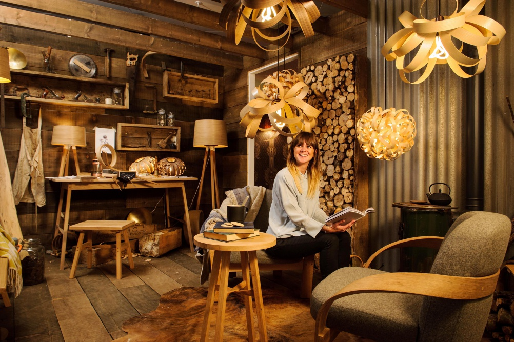 Tom Raffield's log cabin creative space.
