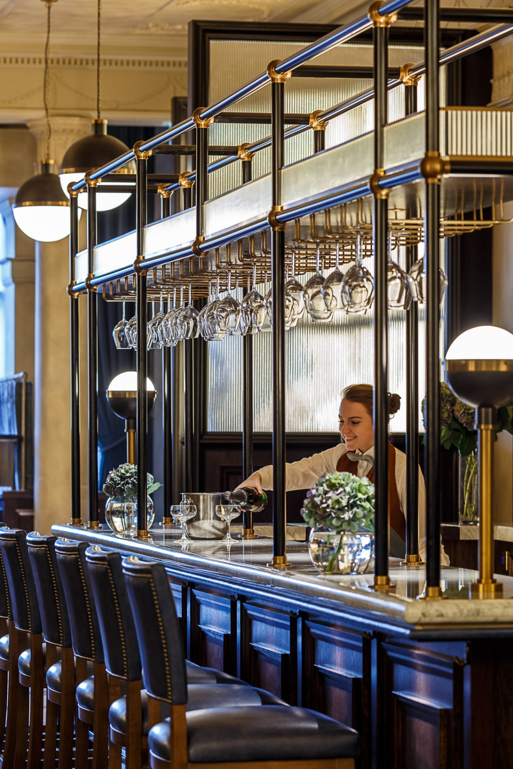 11 - The bar has bespoke black metal and brass gantries with inset lighting to set off glass and spirit displays