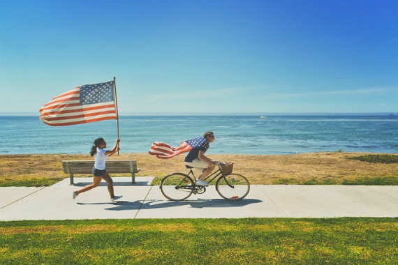 Cyclists and joggers with US flag