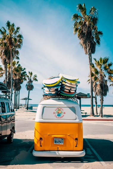 VW bus on the beach in the USA