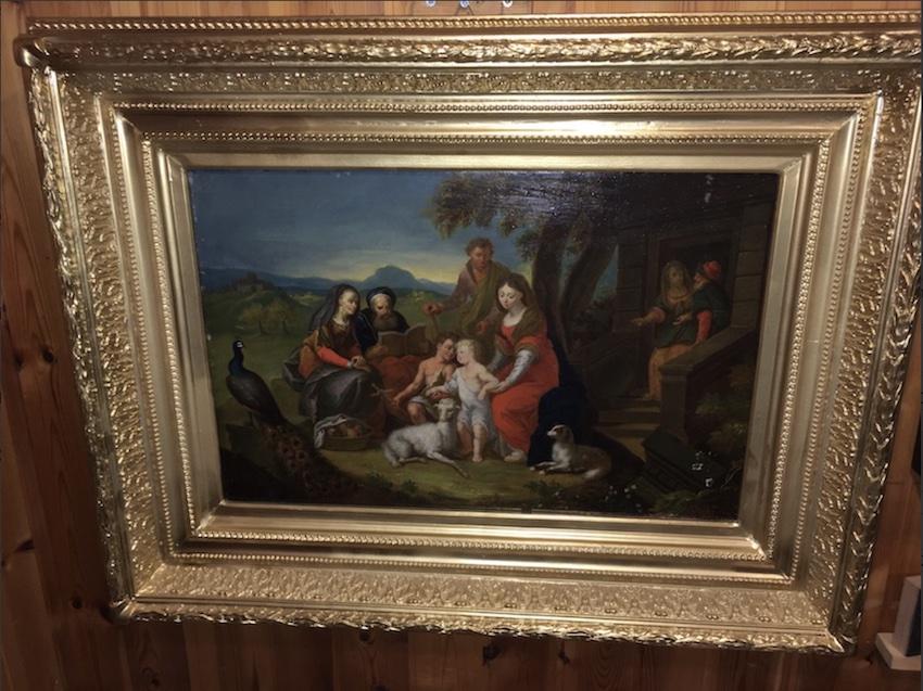 La Sacra Famiglia e il giovane Giovan Battista in un paesaggio.