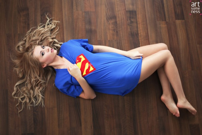 blonde model laying on floor in super man t-shirt
