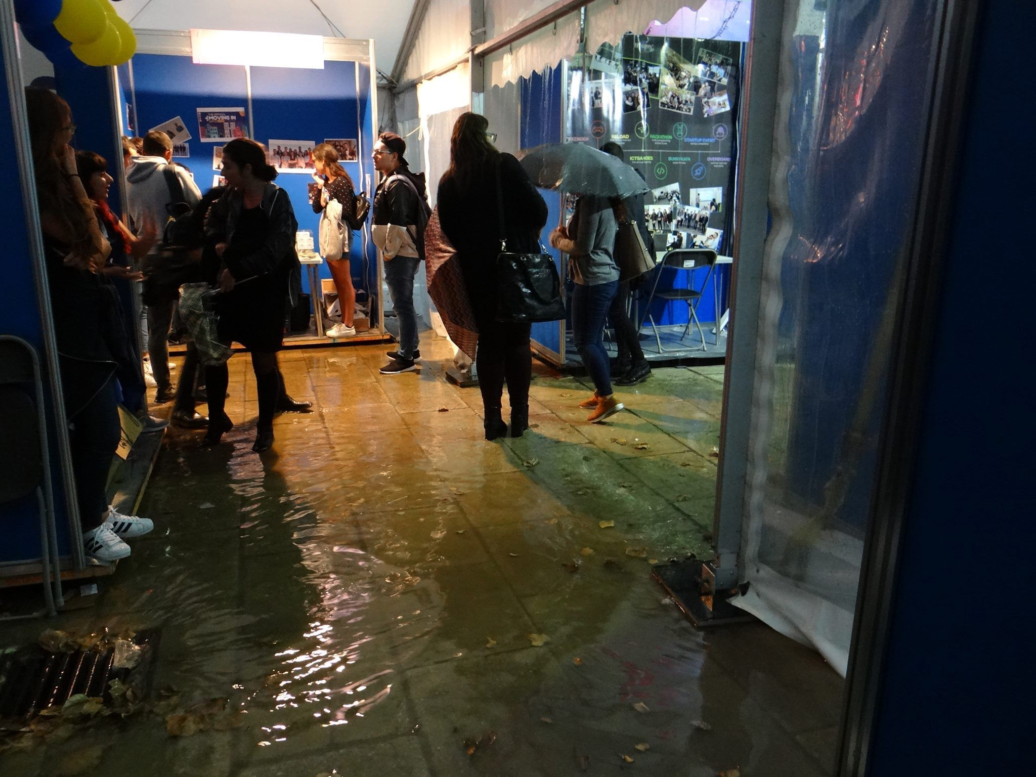 Inches of water covering the area in front of student organisations' stands