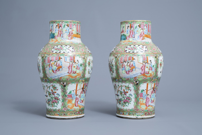 A pair of Chinese Canton famille rose vases and covers, 19th C.