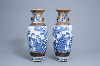 A pair of Chinese blue and white Nanking crackle glazed vases with peacocks among blossoming branches, 19th C.