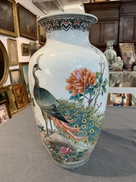 A Chinese famille rose vase with a peacock among blossoming branches, Republic, 20th C.