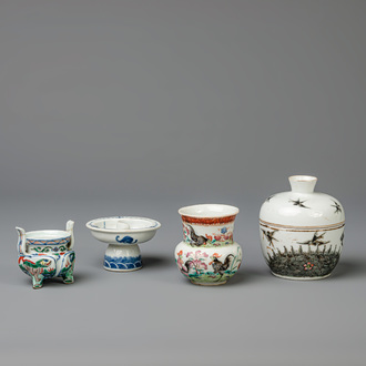 A Chinese incense burner, a stem cup, a box and cover and a vase, famille rose, wucai, etc., 19th/20th C.