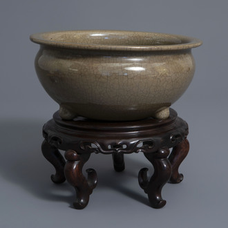 A Chinese crackle glazed tripod incense burner on stand, 19th/20th C.