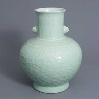 A large Chinese monochrome celadon floral relief decorated vase, Qianlong mark, 19th/20th C.