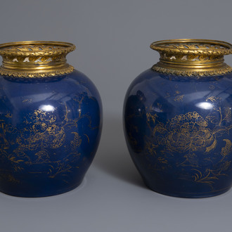 A pair of ormolu mounted Chinese gilt decorated powder blue ground jars, 19th/20th C.