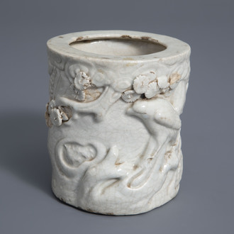 A Chinese monochrome crackle glazed relief decorated brush pot, 19th C.