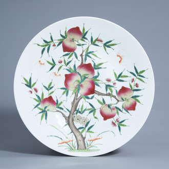 A large Chinese famille rose 'nine peaches' charger, 19th/20th C.