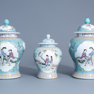 Three Chinese famille rose turquoise ground vases and covers, Qianlong mark, 20th C.