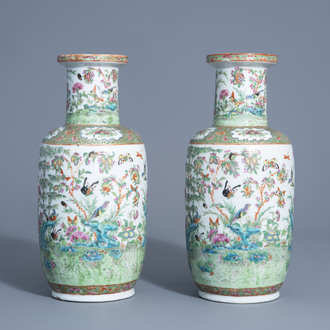 A pair of Chinese Canton famille rose vases with birds and butterflies among blossoms, 19thC.