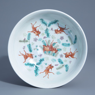 A Chinese iron red sanduo bowl with goldfish, 19th C.