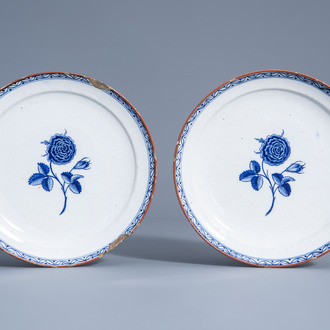 A pair of Dutch Delft blue and white plates with roses, 18th C.