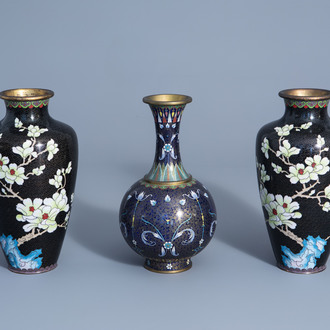 A pair of Chinese cloisonné vases with floral design and a bottle vase, 19th/20th C.