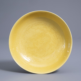 A Chinese monochrome yellow incised 'dragon' saucer dish, Daoguang mark and of the period