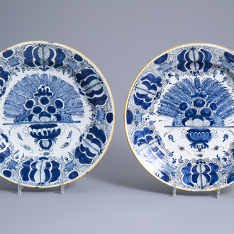 Two Dutch Delft blue and white 'peacock tail' chargers, 18th C.