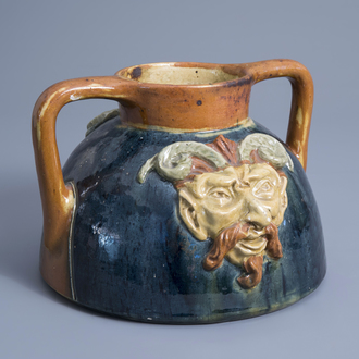 A Flemish polychrome pottery 'mascarons' jug, Torhout, first half of the 20th C.