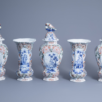 A large Dutch Delft polychrome five-piece garniture with floral design and figures in a landscape, 19th C.
