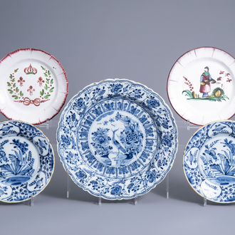 Two Dutch Delft blue and white plates and a charger and two French faience de l'Est plates, 18th/19th C.