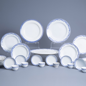 A collection of blue and white Tournai porcelain plates, cups and saucers and a strainer, 19th C.