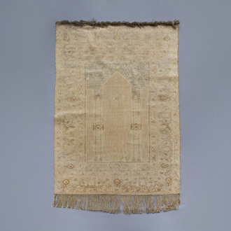 A very fine knotted Turkish prayer rug with different designs, silk on cotton, mid 19th C.