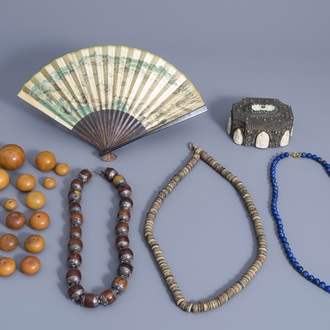 A varied collection of Asian beads, a fan and an inlaid silver box, 19th/20th C.