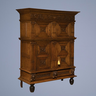 A Dutch carved oak four-door cupboard, 17h C. and later